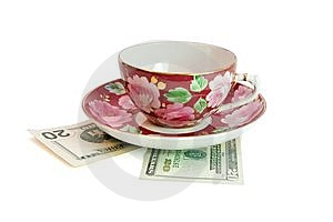 Tea Cup And Saucer On Dollar Bills Isolated Royalty Free Stock Photos - Image: 9698258