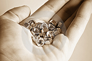 Hand With Bolts And Nuts Royalty Free Stock Image - Image: 9702106