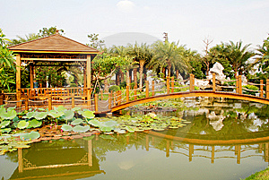 The Wood Bridge And Pavilin In Pond Royalty Free Stock Images - Image: 9703759