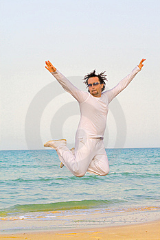 Man In White Jumping On A Beach Stock Image - Image: 9704081
