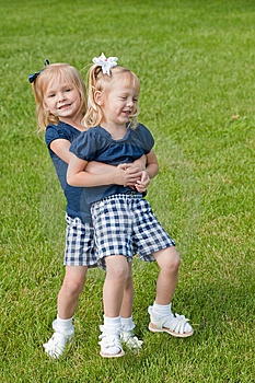 Two Little Girls Hugging Stock Photos - Image: 9719063