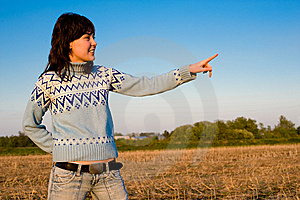 Smiling Girl Showing With Finger. Stock Images - Image: 9741884