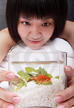 Asian Girl With Her Goldfish Royalty Free Stock Image - Image: 9770946