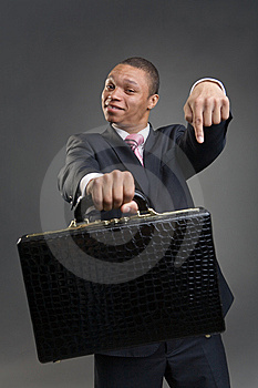 Businessman Offers Briefcase Stock Images - Image: 9789984