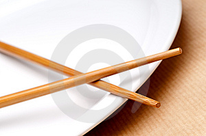 A Pair Of Chopsticks On A White Pla Royalty Free Stock Photos - Image: 9791448