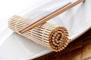A Pair Of Chopsticks And A Sushi Mat Royalty Free Stock Images - Image: 9791749