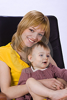 Mother And Daughter Sitting In A Chair Royalty Free Stock Image - Image: 9795306