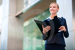 A Beautiful Businesswoman Holding A Clipboard Royalty Free Stock Photography - Image: 9799867