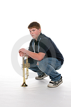 Teenage Boy Leaning On His Upright Trumpet Royalty Free Stock Photo - Image: 9804725