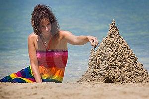 A Woman Building A Sandcastle Stock Photo - Image: 9806400