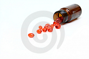 Glass Small Bottle With Medicine Capsules Stock Photos - Image: 9814503