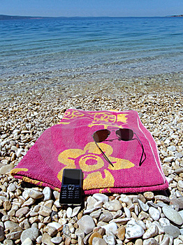 Cellular, Sun Glasses And Pink Towel Stock Images - Image: 9821314