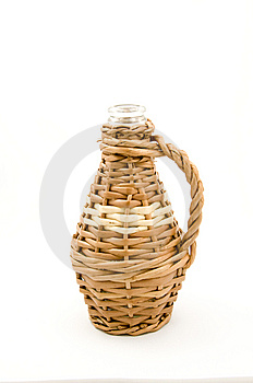 De Fles Van Het Glas In Rieten Weefsel Royalty-vrije Stock Afbeelding - Afbeelding: 9826746