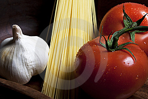 Tomatos And Garlic Royalty Free Stock Photo - Image: 9831575