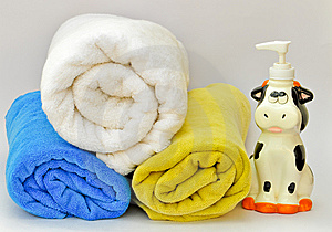 Pile Of Towels With A Liquid Soap Dispenser Royalty Free Stock Photo - Image: 9834095