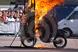 Stunt Rider And Wall Of Flames Royalty Free Stock Images - Image: 9837089