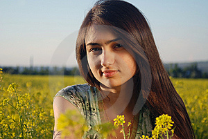 Girl On A Yellow Canola Field Royalty Free Stock Images - Image: 9842379