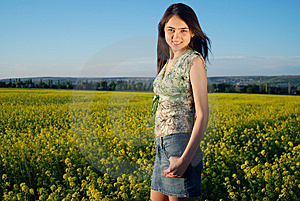 Girl On A Yellow Canola Field Royalty Free Stock Image - Image: 9842486