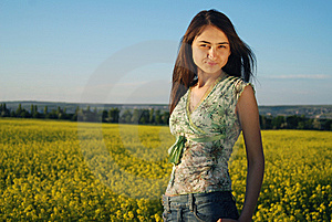 Girl On A Yellow Canola Field Stock Photo - Image: 9842590
