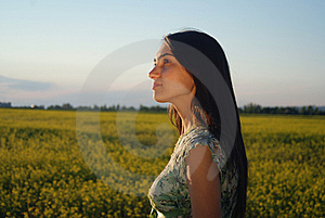 Girl On A Yellow Canola Field Royalty Free Stock Images - Image: 9842609