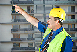 Mature Architect Pointing On Site Stock Image - Image: 9856531