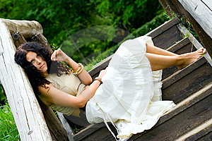 Woman Sitting In Wooden Stairs Royalty Free Stock Photos - Image: 9858968