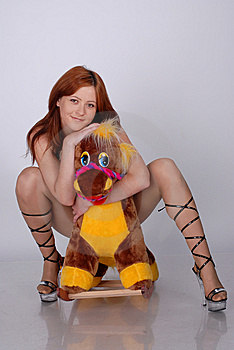 Girl With Toy Horse Stock Image - Image: 9869081