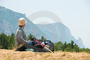 Tired Hiker Relaxes On A Hill Stock Photo - Image: 9878740