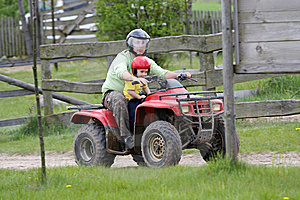 Dad With Son Riding A Quad Royalty Free Stock Photos - Image: 9888388