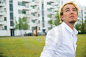 Young Man In Front Of White Buildings Royalty Free Stock Images - Image: 9896029