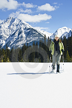 Woman Snowshoeing In The Canadian Rockies Stock Image - Image: 9898411