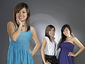 Three Asian Girls Comparing With Each Other Royalty Free Stock Images - Image: 9898909