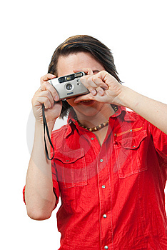 Young Guy Photographs Something. Royalty Free Stock Photos - Image: 9901618