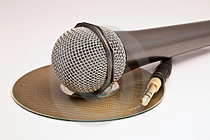 A Microphone And A Jack Over A CD. Stock Images - Image: 9901914