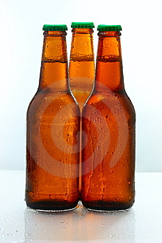 Three Beer Bottles Abreast Royalty Free Stock Image - Image: 9902976