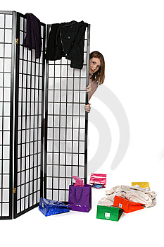 Shopping Teen Peeking From Behind A Screen Stock Image - Image: 9909731