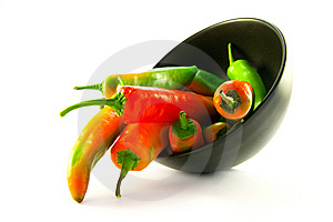 Chillis Spilling Out Of A Black Bowl Royalty Free Stock Images - Image: 9914509
