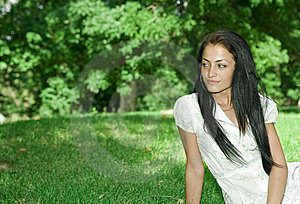 Attractive Girl Sitting On The Grass Royalty Free Stock Photography - Image: 9920527