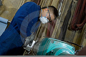 Polishing Metal In Workshop Royalty Free Stock Photography - Image: 9928237