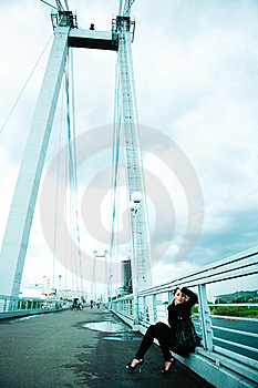 Lonely Girl On The Bridge Royalty Free Stock Photography - Image: 9953877