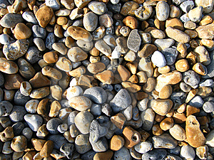 Stock Image - Sunlight on pebbles
