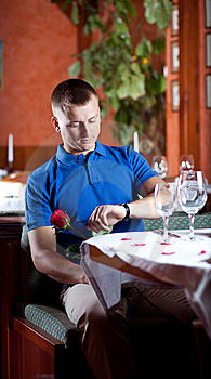 The Man With Red Rose  In Restaurant Royalty Free Stock Photos - Image: 9962718