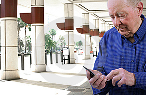 Elderly Man  Dialing Cell Phone Stock Photo - Image: 9971530