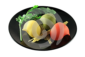 Pasta Of Different Colors And Forms On Black Plate Royalty Free Stock Photography - Image: 9985467