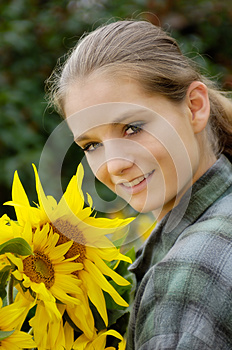 Young Woman With Sunflowers Royalty Free Stock Images - Image: 9995429