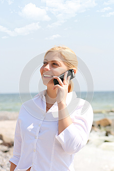 Business Woman Talks By Phone Royalty Free Stock Images - Image: 9998859